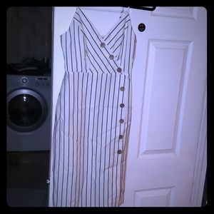 Brand new with tag. Ivory and black stripes